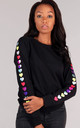 Regular Sweatshirt in Black with Glitter Heart Sleeves by LimeBlonde