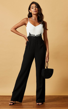 Strappy Jumpsuit With Lace Detail In Black And White by Phoenix & Feather Product photo