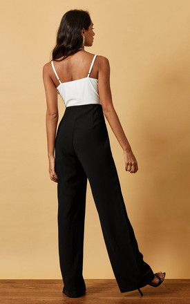 STRAPPY JUMPSUIT WITH LACE DETAIL IN BLACK AND WHITE by Phoenix & Feather