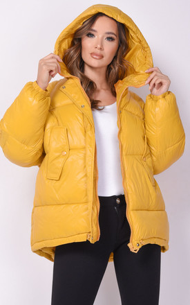 oversized puffer coat in yellow wet look by LILY LULU FASHION