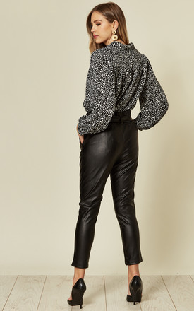 Black PU High Waisted Paper Bag Slim Fit Pants With Elasticated Waist And Tie Front by Off The Railz