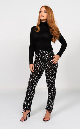 Cropped polka dot leggings in black/white by Miss Attire