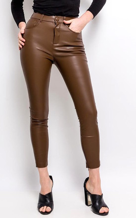 The Cheshire Chocolate Pants/ Jeans In Faux Leather by Brunch Club Girls. Product photo