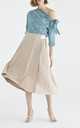 Marylebone Side Pleated Midi Skirt in Beige by Paisie