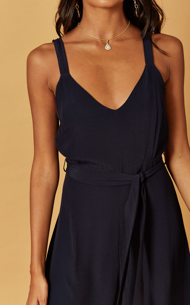 STRAPPY JUMPSUIT WITH SPLIT LEG IN NAVY by Phoenix & Feather