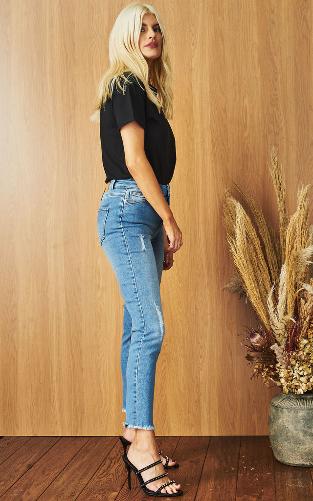 Distressed Denim Jeans in Light Blue by Pieces