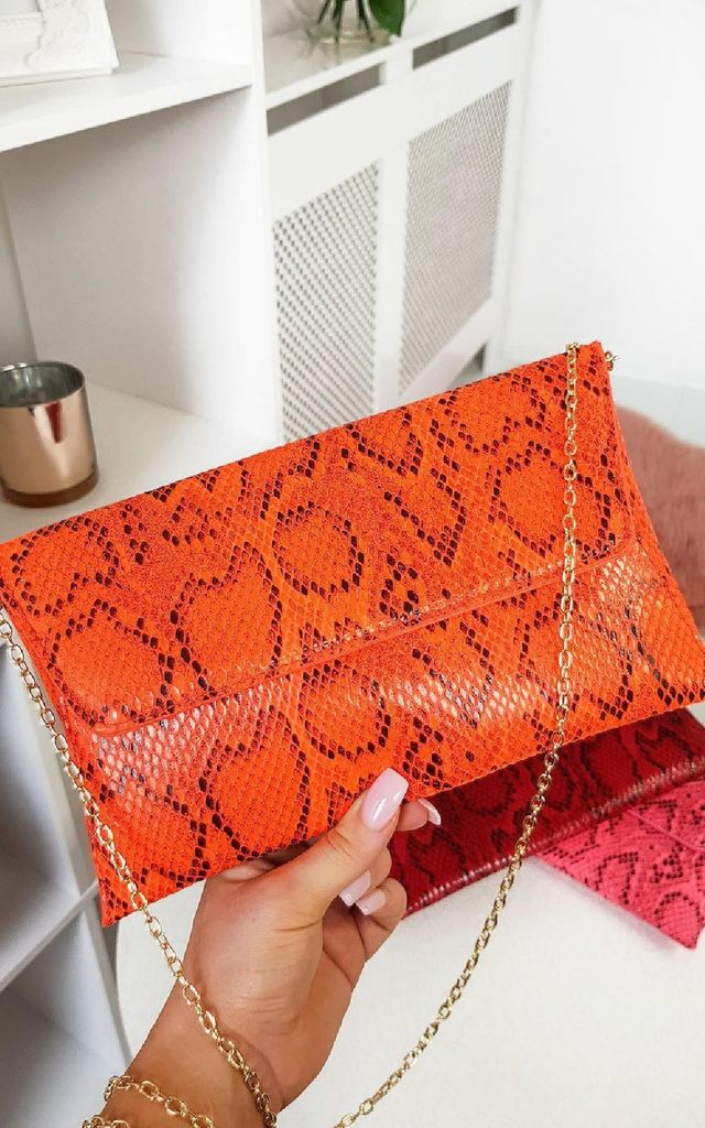 Melinda Orange Snake Print Clutch Bag by IKRUSH