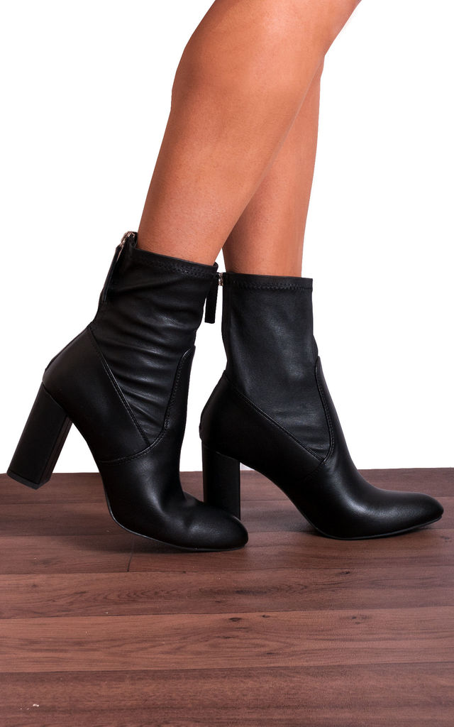 Black Leather Heeled Sock Boots by Shoe Closet