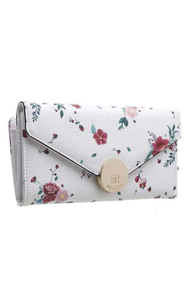 FLAP OVER PURSE IN WHITE FLORAL PRINT by BESSIE LONDON
