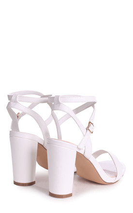 True Love White Block Heeled Sandals With Crossover Ankle Strap by Linzi