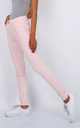Toxik Mid Rise Jeans in Light Pink by Azzediari Clothing