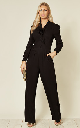 Black Long Sleeve Jumpsuit with Pussy Bow by Hearts and Roses London