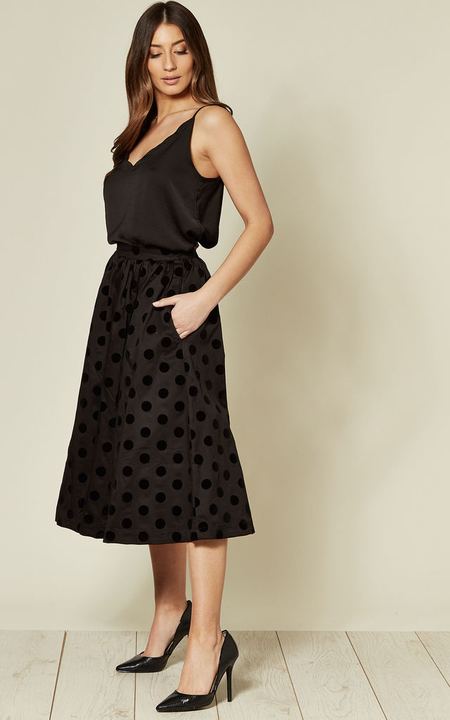 Polka Dot Flocked Midi Skirt in Black by Hearts and Roses London