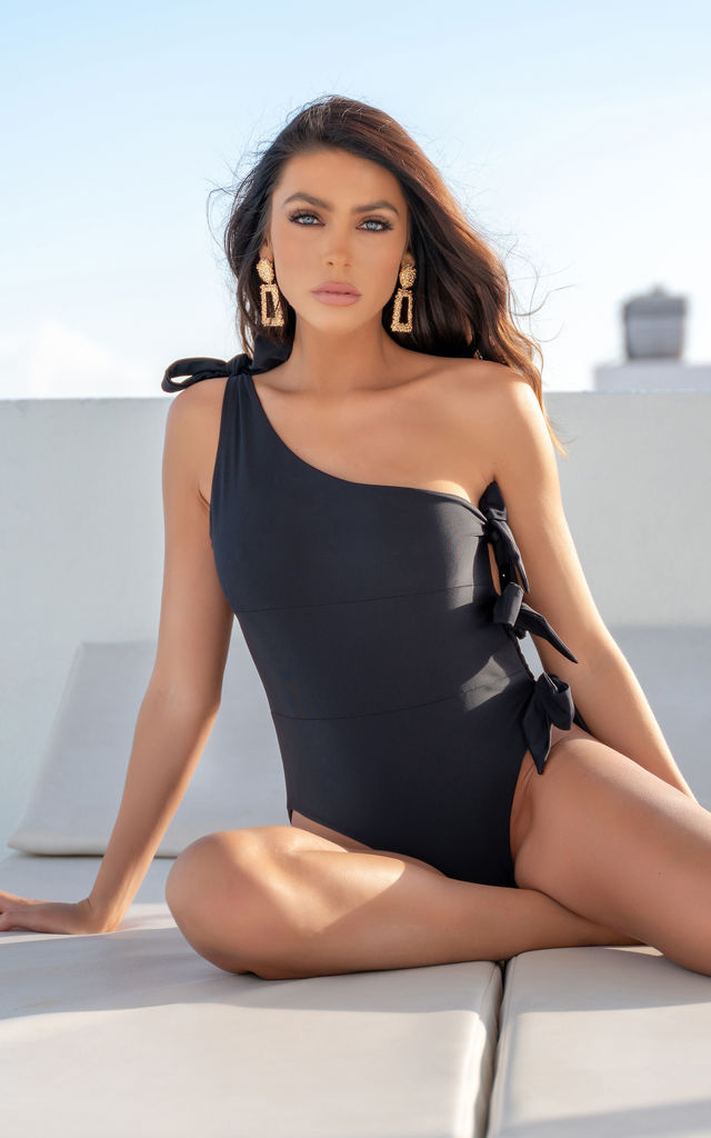 BLACK ONE SHOULDER SWIMSUIT WITH TIE SIDE by THE GLAMBASSADORS™ RESORTWEAR