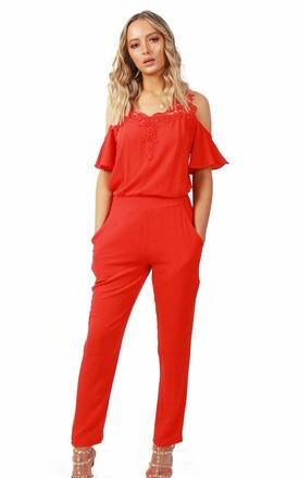 CORAL COLD SHOULDER JUMPSUIT WITH RUFFLE SLEEVES & LACE APPLIQUE by LOES House