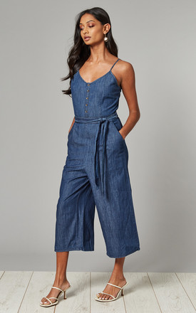 Strappy denim jumpsuit with tie belt by Yumi