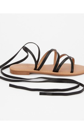 Lace Up Faux Leather Flat Sandals In Black by LILY LULU FASHION Product photo