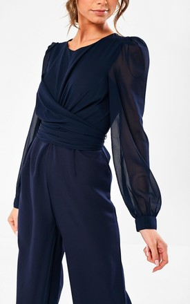 Long Sleeve Jumpsuit in Navy by Marc Angelo
