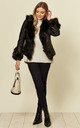 Faux fur leather jacket with tie in Black by LOES House
