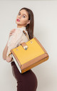 RING CHAIN HANDLE SHOULDER BAG in YELLOW by BESSIE LONDON