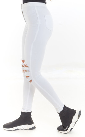 Mid Rise Skinny Jeans with Ripped Knees in White by Luna Boutique