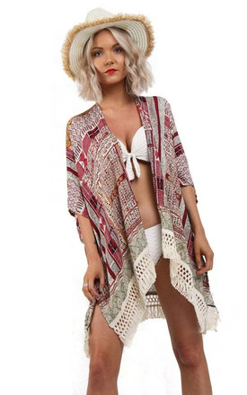 GEOMETRIC PRINT TASSEL TRIM KIMONO IN Pink by LOES House