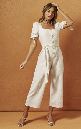 CLEO BUTTON FRONT JUMPSUIT IN WHITE by Charlie Holiday