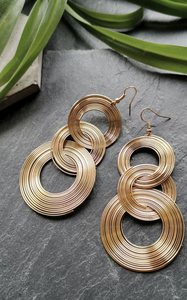 Gold Tone Circle Spiral Drop Earrings by Xander Kostroma