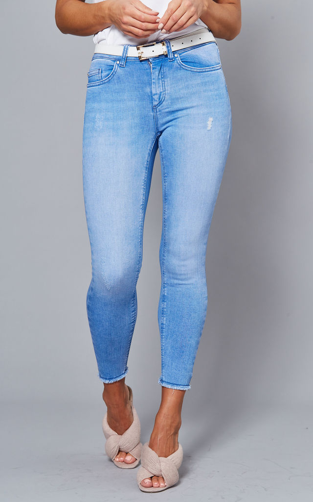 Skinny Ankle Jeans with raw hem in Light Blue by ONLY