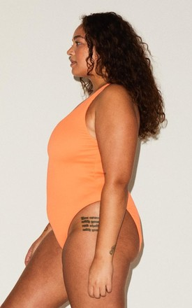 LILY REVERSIBLE HIGH LEG SWIMSUIT in ORANGE/RUST by We Are We Wear