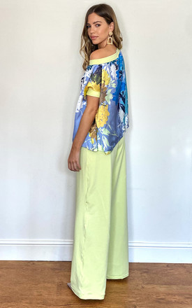 Lemon sorbert and blue flower co-ord trouser suit by Mccullock Women