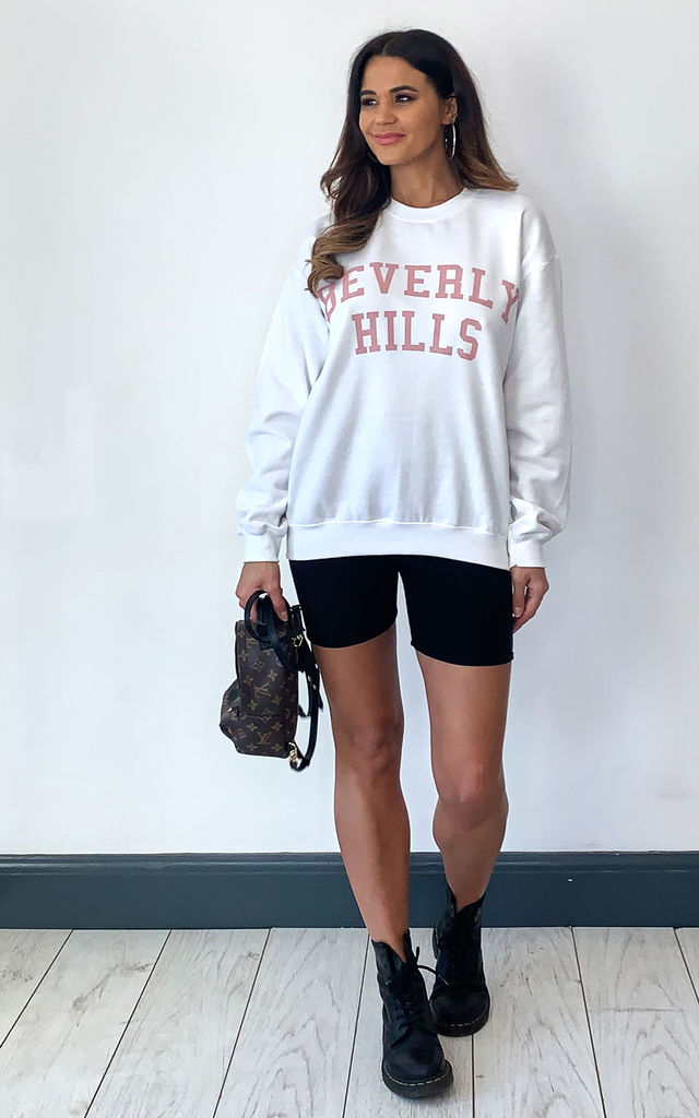 Pink Beverly hills slogan long sleeve oversized jumper in white by Pharaoh London