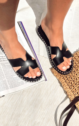 Black Cut Out Slip On Sandals by Truffle Collection Product photo