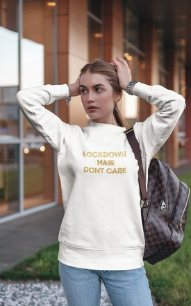 Cream Sweater with Lockdown hair Don't Care Slogan by Adolescent Clothing