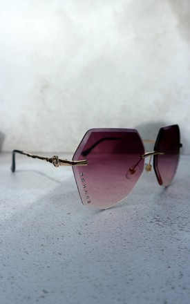 Purple tinted frame sunglasses by Unscripted