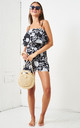 Melrose Tiered Layer Floral Playsuit in Black by love frontrow