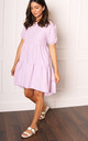 Cotton Voluminous Tiered Dip Hem Smock Dress with Short Puff Sleeves in Lilac by One Nation Clothing