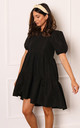 Cotton Voluminous Tiered Dip Hem Smock Dress with Short Puff Sleeves in Black by One Nation Clothing