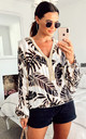 Multi coloured leaf print loose fitted v neck top by Port boutique