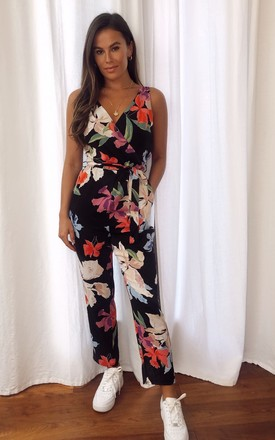 Melissa Wrap Neck Straight Leg Jumpsuit Black Floral by Girl In Mind