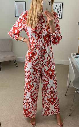 Red and white formal jumpsuit by Luxy Boutique