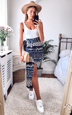 Daisy Floral Midi Wrap Skirt In Navy by D.Anna Product photo
