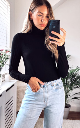 Roll Neck Ribbed Long Sleeved Top In Black by VILA Product photo