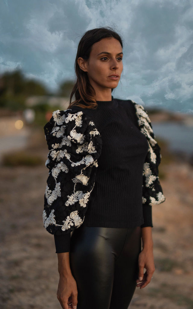 Raquelle jersey top in black with sparkle lace sleeves by AMO
