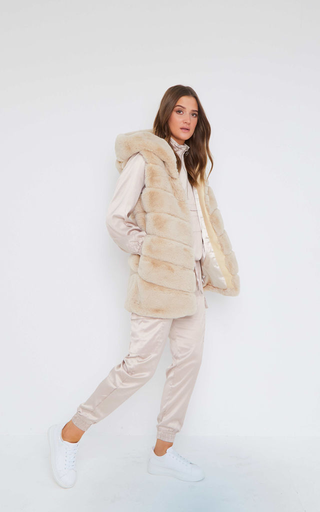 Cream Hooded Faux Fur Gilet by Mimi Clothing