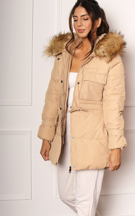 Clara Quilted Longline Hooded Puffer Coat with Faux Fur Trim & Tie Waist in Cream Beige by One Nation Clothing
