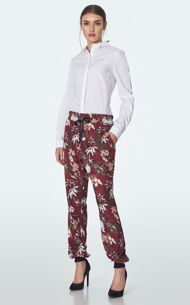 Loose Trousers Tied at Waist in Maroon Floral Print by so.Nife