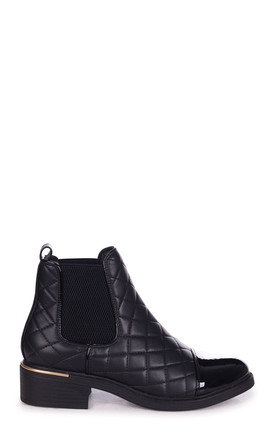Zimi Black Nappa Quilted Chelsea Boot With Patent Toe Cap And Gold Heel Trim by Linzi