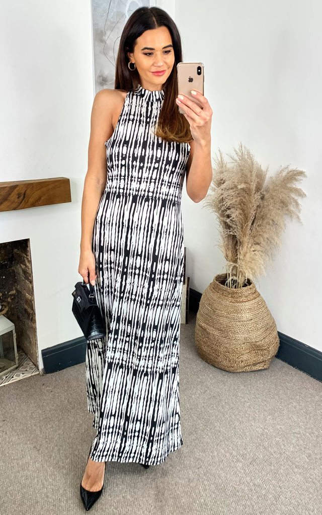 BLACK AND WHITE BODYCON MAXI DRESS WITH HALTER NECK AND CUT OUT BACK by LOVEMYSTYLE
