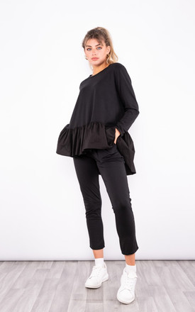 soft knitted RuffLe Hem loungewear set in Black by LOES House